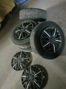 Winter tires with winter rims and hubcap