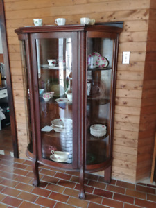 Rounded glass china cabinet