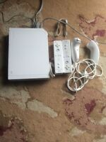 Nintendo wii with 11 games, 2 controllers and microphone