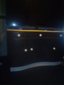 Black and white refurbished sideboard with hand carved floral drawers