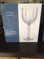4 wine glasses and 4 champagne flutes! New in box