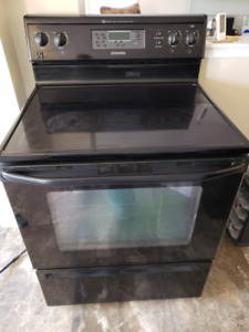Used Black Electric Glass Top Stove and Microwave Oven