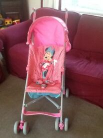 Lovely Mothercare Mini Mouse Stroller pink fold up pushchair with rainwear.