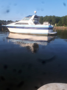 29 Ft 1984 Cruiser Inc. Motor Boat with dual 350's