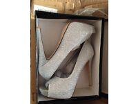 Silver diamonty high heels size 7