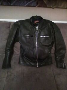 Thick leather motorcycle jacket w/ removable liner .