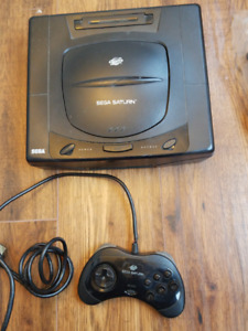Sega Saturn with game, controller and hookups