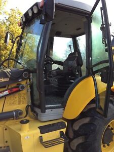 new holland B95C 2014 (900 hrs) West Island Greater Montréal image 7
