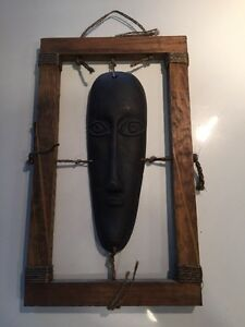 Unique African mask with wooden frame