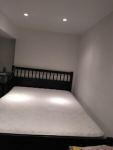 Black Ikea bed with mattress and bed box