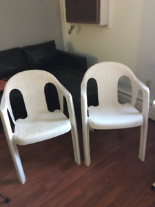 Two white patio chairs