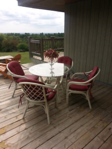 Rattan glass top with 4 chairs and cushions