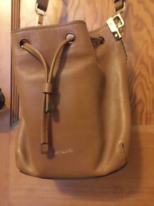 Auxiliary cross body bag