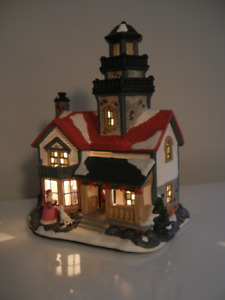 Maison illuminée pour village de Noel