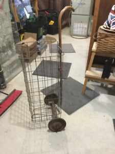 Vintage wire grocery carts baskets on wheels