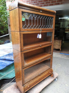 antique 4 level barrister bookcase with upper lead door, drawer