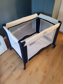 Brand new tavel cot with various packs of brand new nappies