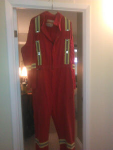clean used fire retardent coveralls with hi vis safety stripes
