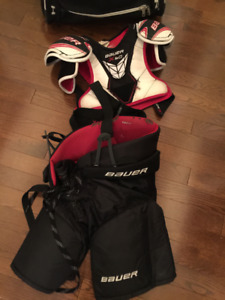 Bauer hockey pants and chest protector, youth medium.
