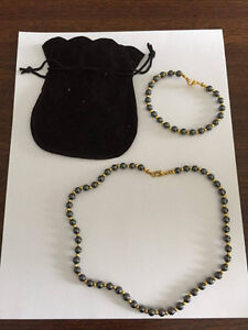 Brand new black/grey/gold necklace and braclet set w/ pouch