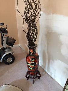 vase with sticks and stand