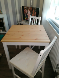 Wooden table and 2 chairs with cushions