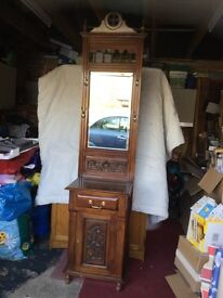 A TALL HALL STAND WITH MIRROR, DRAWER AND CUPBOARD