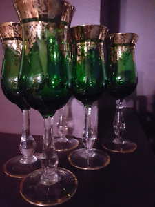 Set of five Italian glass wine glass. Green with gold trim.