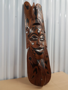 Decorative carved wooden masks