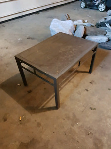 Metal frame glass top outdoor side table.