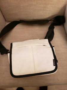 White camera bag. Unused