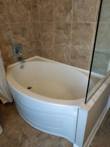 Bathtub with matching shower curtain rod and shower glass