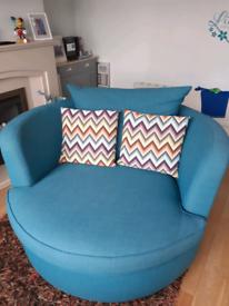 Swivel cuddler chair