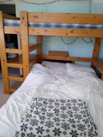 Bunk bed with integrated desk and sofa bed