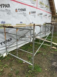 Scaffold with braces and planks