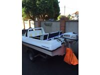 Waterroo 5hp four stroke outboard. Solid trailer and light board. Great fun rivers/canal/sea