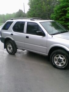 1998 and a 99 Isuzu Rodeo SUV, Crossovers