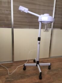 FACAIL STEAMER for SALE. BRAND NEW. ON CASTERS. SWIVEL HEAD.