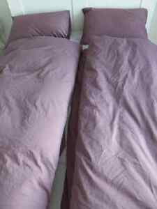 two sets of bed sheets (twin size)plus fitted sheet (queen size)