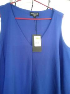 Très belle robe neuf jamais porter gr Xl pour 20$