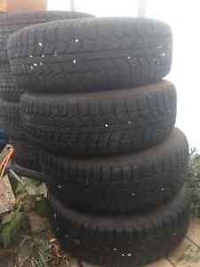 Uniroyal Tigerpaw snow tires on rims