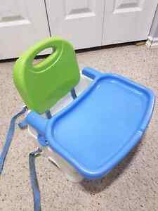Highchair,  attached to chair