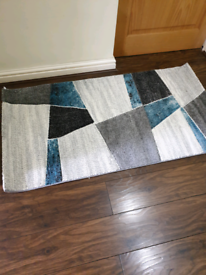 Turquoise patterned rug