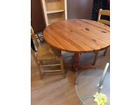 Pine table and two chairs for sale