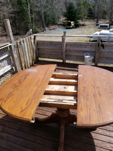 Expanding dining table and chairs