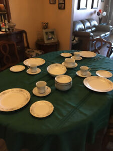 8 piece set of good dishes and silverware.