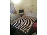 White frame double bed