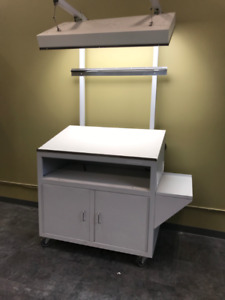 Drafting table with cabinet