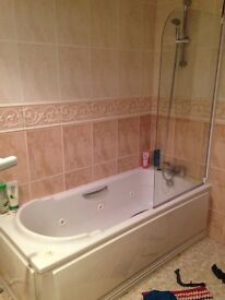 Jacuzzi bath. Shower mixer taps, shower rail and shower screen.