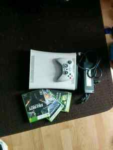 Xbox 360 with call of duty and rock band 2 and 2 other games